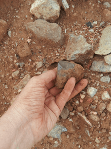 image of Genn John digging crystal